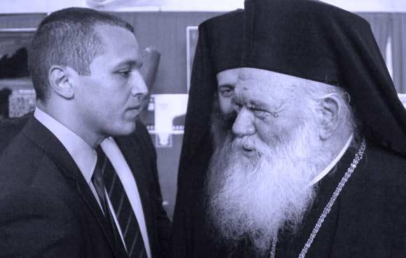 Το ένα θέμα είναι η συμπεριφορά του Αρχιεπισκόπου προς τον εκπρόσωπο μιας υπόδικης (και με τουλάχιστον 21 καταδίκες μελών μέχρι στιγμής) χιτλερικής σατανιστικής οργάνωσης και η απόλυτη σιωπή όλης της Αριστεράς γι'αυτήν την φωτογραφία, που πάρθηκε στην τελετή υποδοχής των οστών των νεκρών του Νοράτλας στο στρατιωτικό αεροδρόμιο Τατοϊου. Το άλλο είναι η συνήθης δολοφονία της Ιστορίας. Οι 31 Έλληνες στρατιώτες του Νοράτλας, στις 22 Ιουλίου 1974, σκοτώθηκαν κατά λάθος από πυρά της χουντικής κυπριακής Εθνοφρουράς, απεσταλμένοι χωρίς ενημέρωσή της, πρόχειρα, από την πανικόβλητη Χούντα της Αθήνας, που με το προδοτικό της πραξικόπημα είχε προκαλέσει την τουρκική εισβολή. Στην υποδοχή των οστών αυτών των θυμάτων της Χούντας, παραβρίσκεται και ο πολιτικός κληρονόμος της Δικτατορίας στην πιο ακραία ναζιστική εκδοχή της. Τον χαιρετά ο Ιερώνυμος Β΄ της Εκκλησίας του Ιερώνυμου Α΄, η οποία συνεργάστηκε απόλυτα και με τρόπο εξευτελιστικό με τη Χούντα και που μόλις προχτές, επωφελούμενη από το καθεστώς λήθης που έχει επιβάλλει-δια στόματος του ίδιου του πρωθυπουργού-η παρέα του ΣΥΡΙΖΑ, τόλμησε να διεκδικήσει και αντιστασιακές δάφνες.
