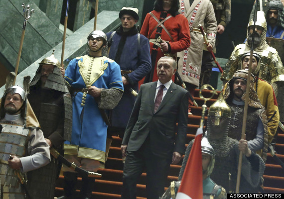 Turkish President Recep Tayyip Erdogan walks between the honor guards wearing historic Turkish warriors costumes before a ceremony for his Palestinian counterpart Mahmoud Abbas at his new presidential palace in Ankara, Turkey, Monday, Jan. 12, 2015. Abbas is in Turkey for a state visit.(AP Photo/Adem Altan, Pool)